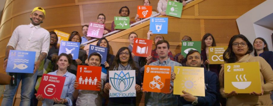 Students show off the UN Global Goals cards