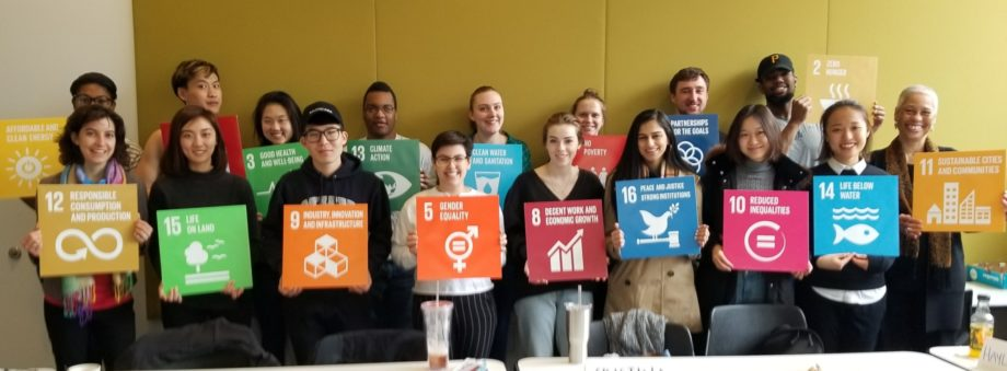 Students at the Weatherhead School of Management show off the UN SDG cards