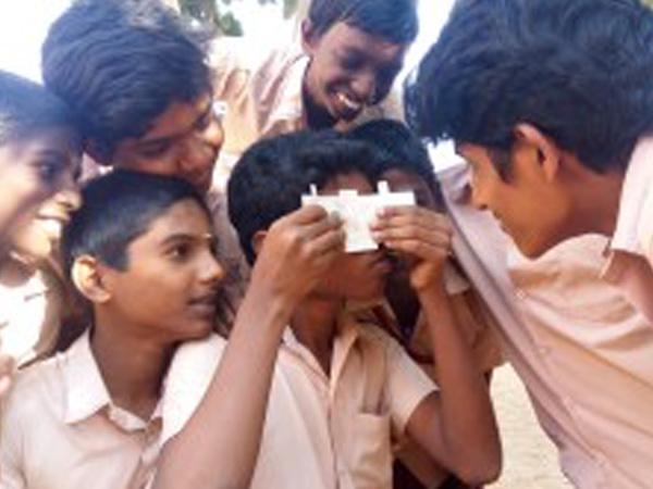 Unfolding Curiosity with a $1 Microscope